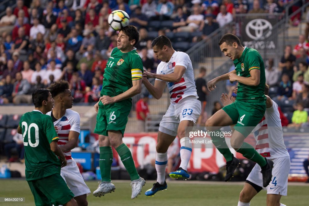 Ronald Raldes #16 of Bolivia plays the ball off his head against Rubio Rubin #23 of the United States in the second half of the friendly soccer match at Talen Energy Stadium on May 28, 2018 in Chester, Pennsylvania. The United States defeated Bolivia 3-0.