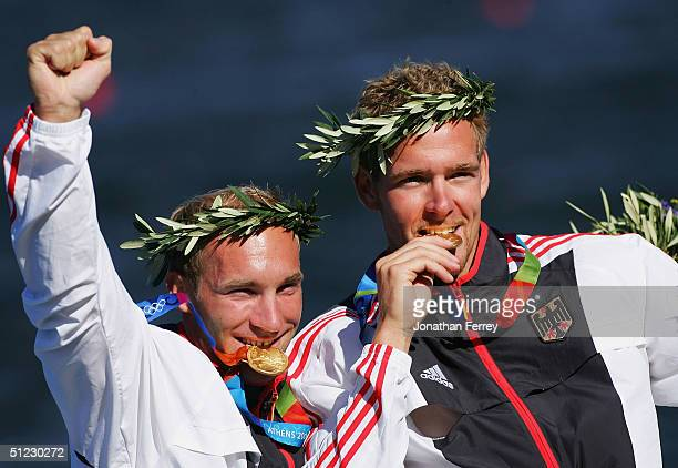 Ronald Rauhe and Tim Weiskoetter of Germany display their gold medals durng the medal ceremonies during the men's K2 class 500 metre final on August...