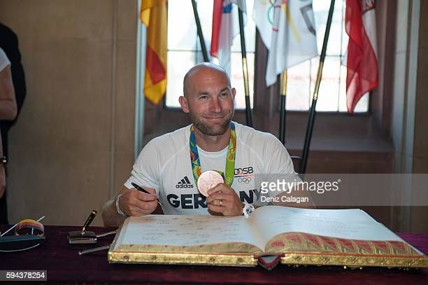 Ronald Rauhe signs the golden book of Frankfurt on August 23 2016 in Frankfurt am MaIN GERMANY