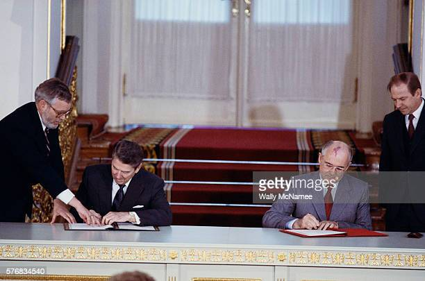 Ronald Reagan and Mikhail Gorbachev sign the IntermediateRange Nuclear Forces Treaty which eliminated the entire category of medium range nuclear...