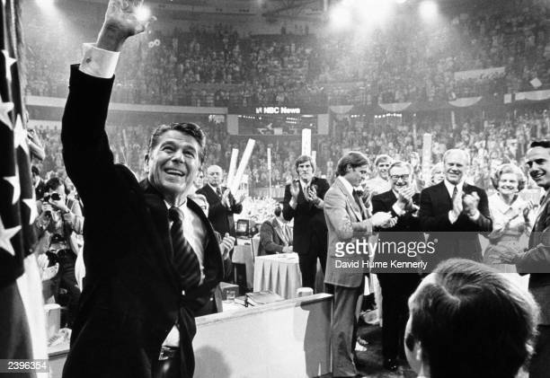 Ronald Reagan waves to the crowd on the final night of the Republican National Convention August 19 1976 in Kansas City Missouri Behind Reagan stands...