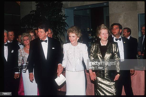 Ronald Reagan wife Nancy and former British Prime Minister Margaret Thatcher hold hands at his eightieth birthday celebration at the Beverly Hilton...