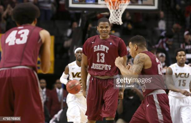 Ronald Roberts Jr #13 and Chris Wilson of the Saint Joseph's Hawks celebrate after a play against the Virginia Commonwealth Rams during the...