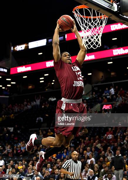 Ronald Roberts, Jr. #13 of the Saint Joseph's Hawks goes up for a dunk in the first half against the Virginia Commonwealth Rams during the...