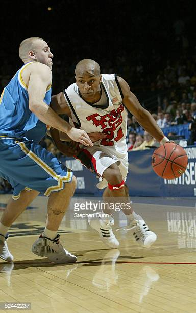 Ronald Ross of the Texas Tech Red Raiders drives on Brian Morrison of the UCLA Bruins during the first half of the first round of the NCAA Men's...