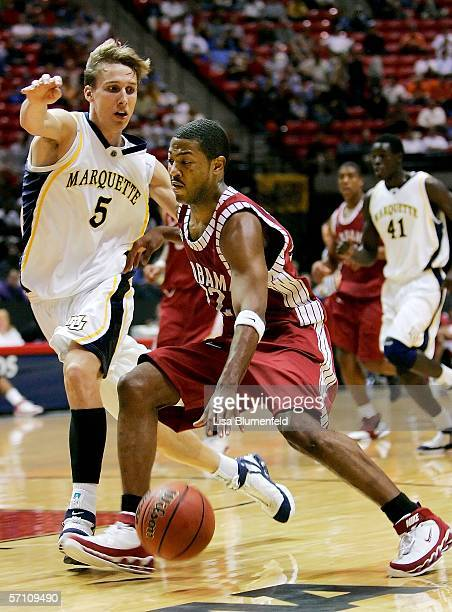 Ronald Steele of the Alabama Crimson Tide drives against Dan Fitzgerald of the Marquette Golden Eagles during the first round of the NCAA Finals on...