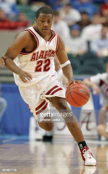 Ronald Steele of the Alabama Crimson Tide moves the ball in the game against the Mississippi Rebels during the quarterfinals of the SEC Men's...