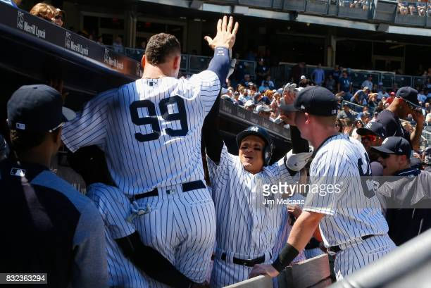 Ronald Torreyes and Aaron Judge of the New York Yankees celebrate against the Tampa Bay Rays at Yankee Stadium on July 30 2017 in the Bronx borough...