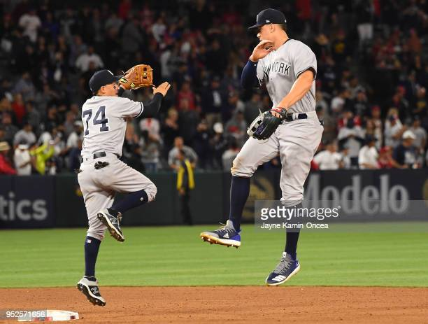 Ronald Torreyes and Aaron Judge of the New York Yankees celebrate after defeating the Los Angeles Angels of Anaheim at Angel Stadium on April 28 2018...