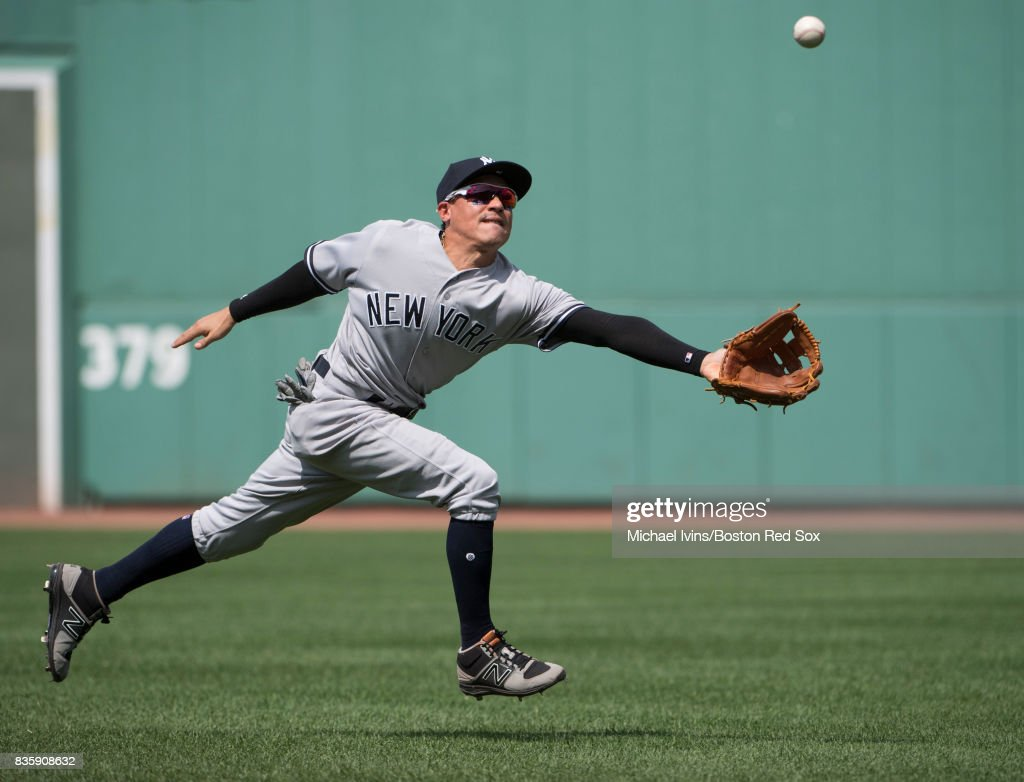 Ronald Torreyes #74 of the New York Yankees attempts to catch a single hit by Xander Bogaerts #2 of the Boston Red Sox in the second inning at Fenway Park on August 20, 2017 in Boston, Massachusetts.
