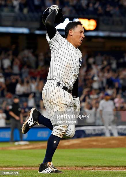 Ronald Torreyes of the New York Yankees celebrates after a walkoff single against the Texas Rangers during the tenth inning at Yankee Stadium on June...