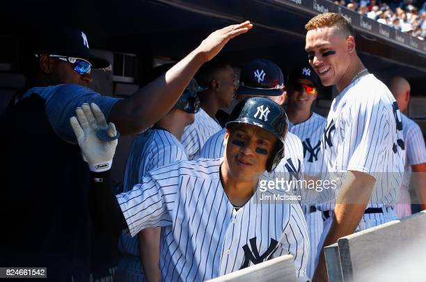 Ronald Torreyes of the New York Yankees celebrates his two run home run against the Tampa Bay Rays at Yankee Stadium on July 30 2017 in the Bronx...