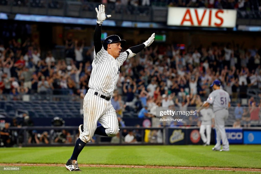 Ronald Torreyes #74 of the New York Yankees celebrates hitting a walk off single off of Matt Bush #51 of the Texas Rangers during the tenth inning at Yankee Stadium on June 23, 2017 in the Bronx borough of New York City.
