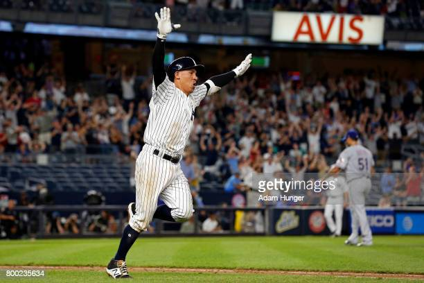 Ronald Torreyes of the New York Yankees celebrates hitting a walk off single off of Matt Bush of the Texas Rangers during the tenth inning at Yankee...