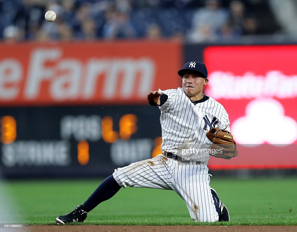 Ronald Torreyes #17 of the New York Yankees fields a hit by Melky Cabrera #53 of the Chicago White Sox in the first inning at Yankee Stadium on May 13, 2016 in the Bronx borough of New York City.