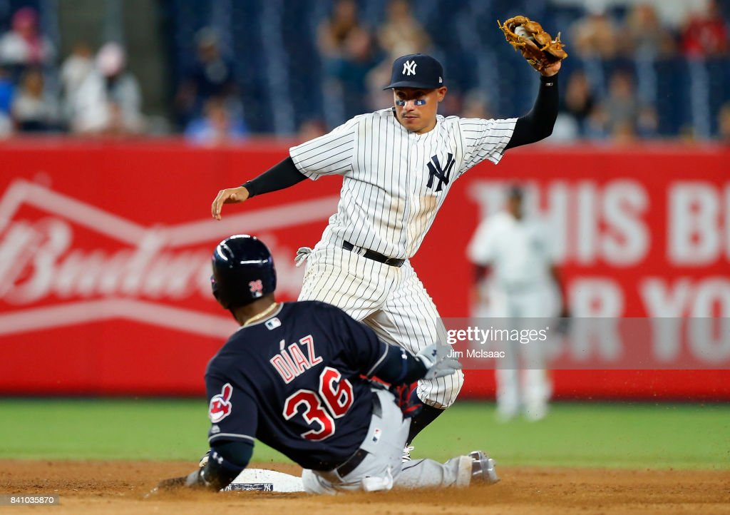 Ronald Torreyes #74 of the New York Yankees forces out Yandy Diaz #36 of the Cleveland Indians during the ninth inning in the second game of a doubleheader at Yankee Stadium on August 30, 2017 in the Bronx borough of New York City.