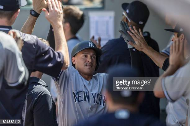 Ronald Torreyes of the New York Yankees is congratulated by teammates after scoring a run on RBIdouble by Clint Frazier of the New York Yankees off...