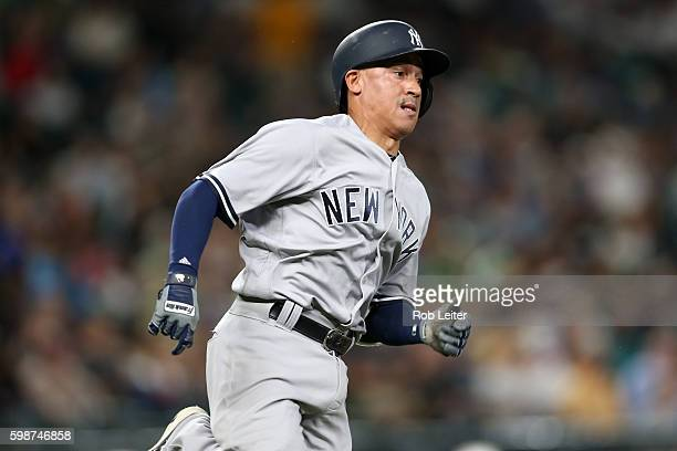 Ronald Torreyes of the New York Yankees runs during the game against the Seattle Mariners at Safeco Field on August 23 2016 in Seattle Washington The...
