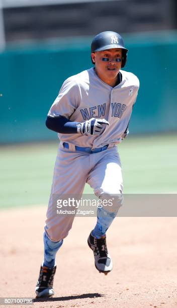 Ronald Torreyes of the New York Yankees runs the bases during the game against the Oakland Athletics at the Oakland Alameda Coliseum on June 17 2017...