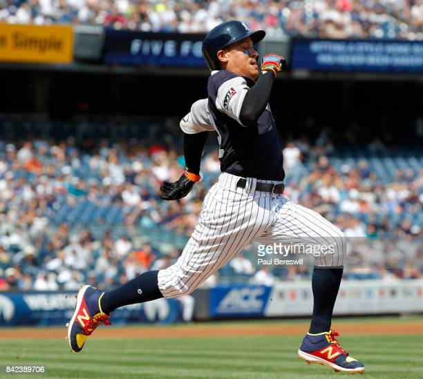 Ronald Torreyes of the New York Yankees runs to first base in an MLB baseball game against the Seattle Mariners on August 27 2017 at Yankee Stadium...