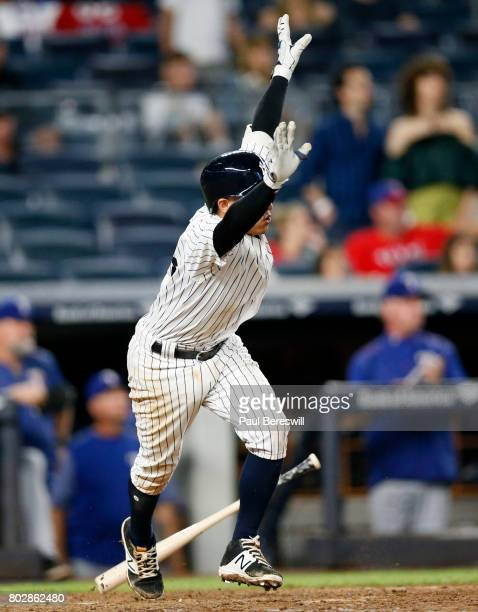 Ronald Torreyes of the New York Yankees runs up the line celebrating his 10th inning single that drove in the winning run in an MLB baseball game...
