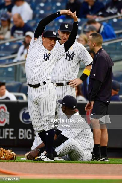 Ronald Torreyes of the New York Yankees stretches before the start of the game against the Boston Red Sox at Yankee Stadium on September 1 2017 in...