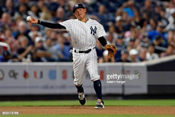 Ronald Torreyes of the New York Yankees throws to first base against the Texas Rangers during the third inning at Yankee Stadium on June 23 2017 in...