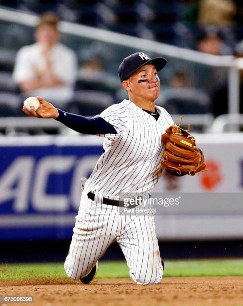 Ronald Torreyes of the New York Yankees throws to second base during an MLB baseball game against the St Louis Cardinals on April 16 2017 at Yankee...