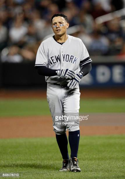 Ronald Torreyes of the New York Yankees walks back to the dugout after hitting a fly ball out to end top of the second inning during an MLB baseball...