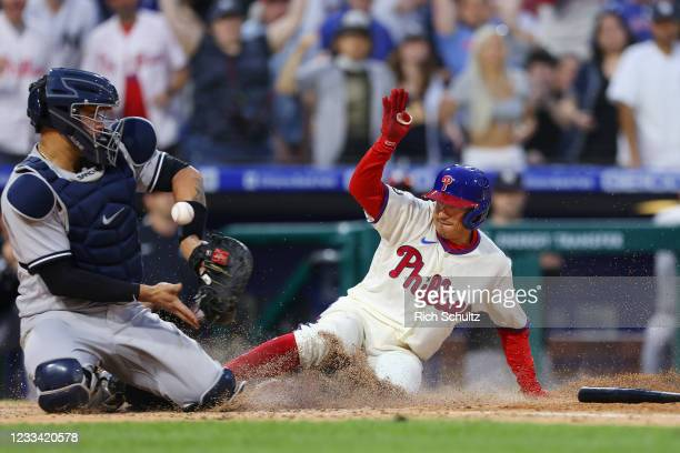 Ronald Torreyes of the Philadelphia Phillies scores the game winning run on a single by Jean Segura as catcher Gary Sanchez of the New York Yankees...
