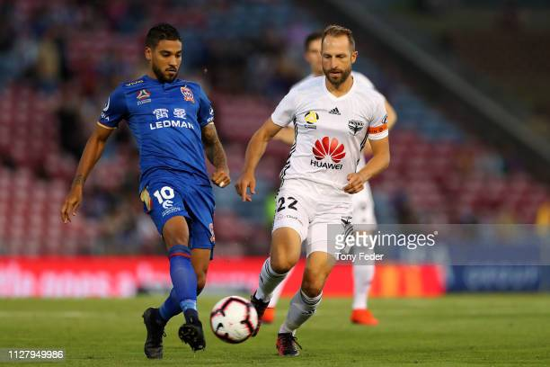 Ronald Vargas of Newcastle Jets contests the ball with Andrew Durante of Wellington Phoenix during the round 18 ALeague match between the Newcastle...