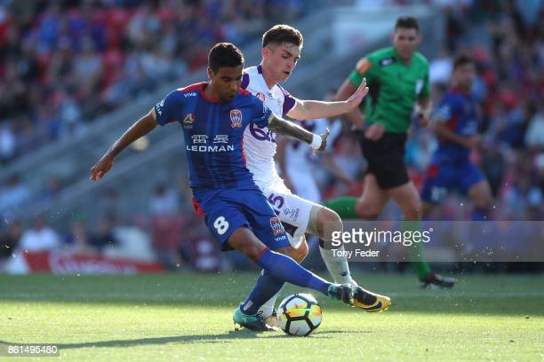 Ronald Vargas of the Jets and Brandon Wilson of the Glory contest the ball during the round two ALeague match between the Newcastle Jets and the...
