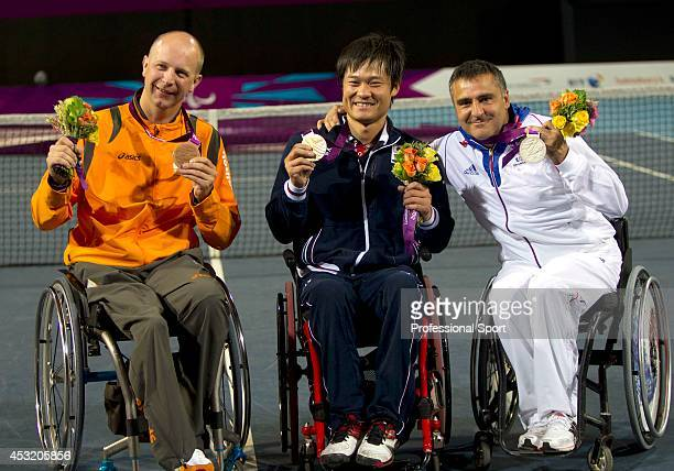 Ronald Vink of Netherlands Shingo Kunieda of Japan and Stephane Houdet of France after the Mens Wheelchair Gold Medal match on day 10 of the London...
