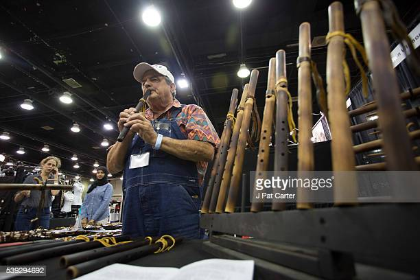 Ronald Willison plays one of the flutes he makes at the Red Earth Native American Festival Friday June 10 2016 in Oklahoma City