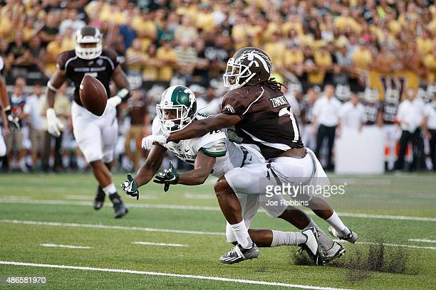Ronald Zamort of the Western Michigan Broncos breaks up a pass intended for Aaron Burbridge of the Michigan State Spartans in the first half at Waldo...