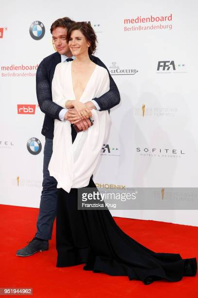 Ronald Zehrfeld and Christina Hecke attend the Lola German Film Award red carpet at Messe Berlin on April 27 2018 in Berlin Germany