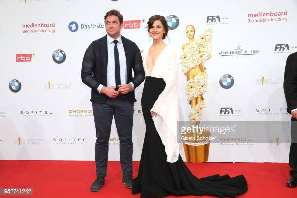 Ronald Zehrfeld and Christina Hecke during the Lola - German Film Award red carpet at Messe Berlin on April 27, 2018 in Berlin, Germany.