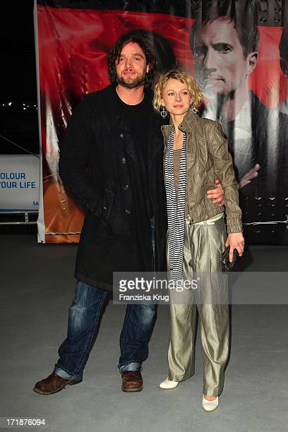 Ronald Zehrfeld and Isabell Gerschke at the Premiere Of Sat1 event twoparter The Border Cinestar in Berlin Sony Center in Berlin