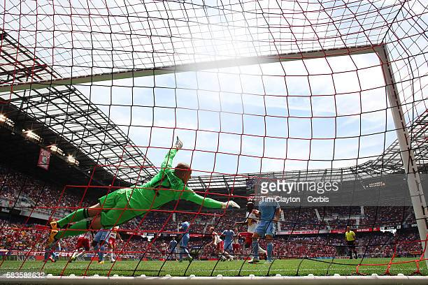 Ronald Zubar of New York Red Bulls heads his sides second goal as he beats a diving goalkeeper Josh Saunders of New York City FC during the New York...