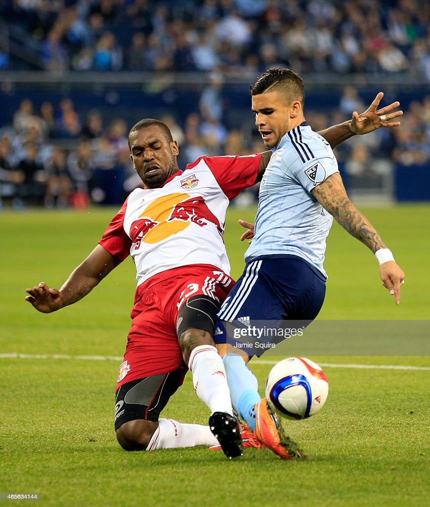Ronald Zubar #23 of New York Red Bulls tackles Dom Dwyer #14 of Sporting KC during the game at Sporting Park on March 8, 2015 in Kansas City, Kansas.
