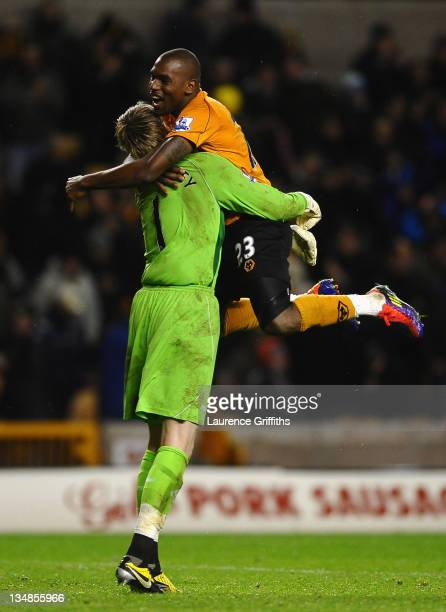 Ronald Zubar of Wolverhampton Wanderers rushes to congratulate Wayne Hennessey at the end of the match after he saved a penalty during the Barclays...