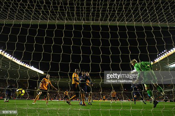 Ronald Zubar of Wolverhampton Wanderers scores an own goal during the Barclays Premier League match between Wolverhampton Wanderers and Arsenal at...