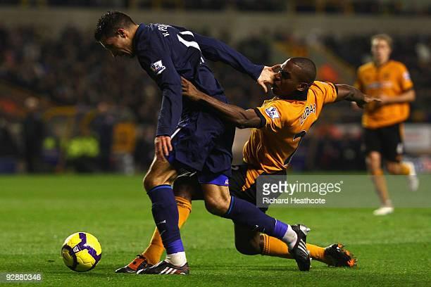 Ronald Zubar of Wolverhampton Wanderers tangles with Robin van Persie of Arsenal during the Barclays Premier League match between Wolverhampton...