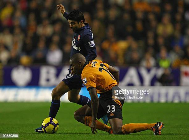 Ronald Zubar of Wolverhampton Wanderers tries to win the ball from Eduardo of Arsenal during the Barclays Premier League match between Wolverhampton...