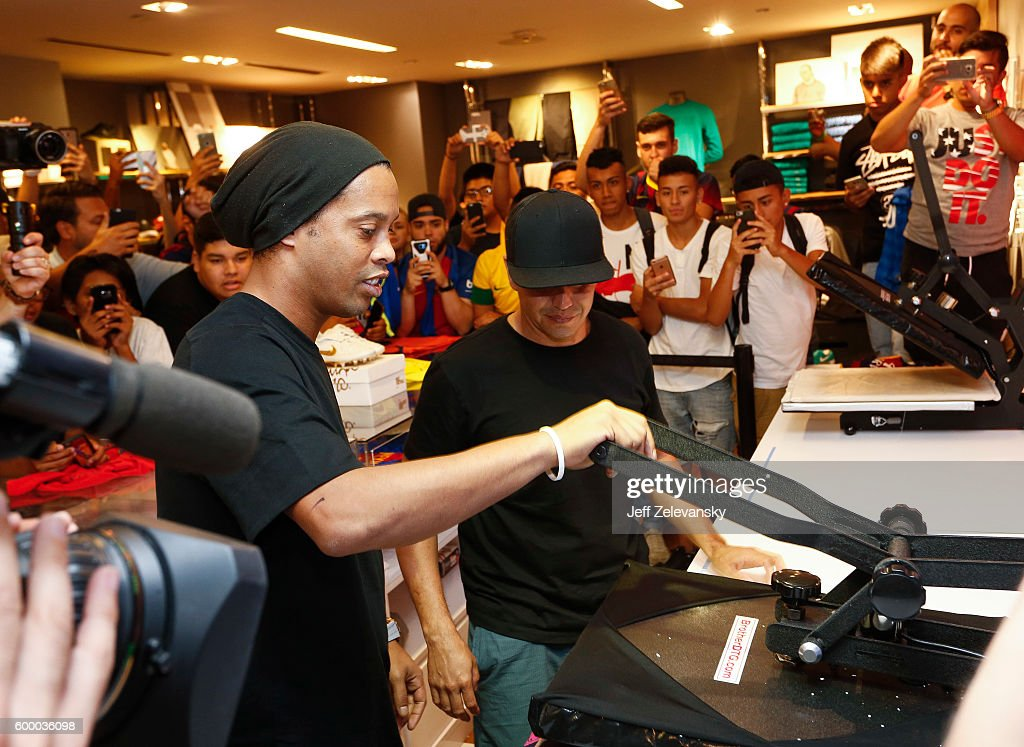 Ronaldhino creates a customized jersey as FC Barcelona fans gather at Niketown to celebrate the Club's arrival to New York on September 7, 2016 in New York City.