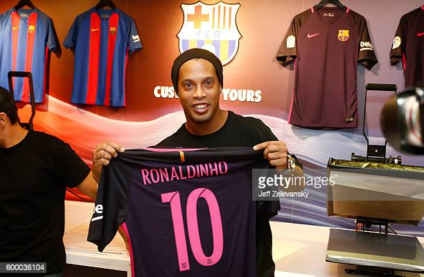 Ronaldhino displays his customized jersey at Niketown to celebrate the Club's arrival to New York on September 7 2016 in New York City