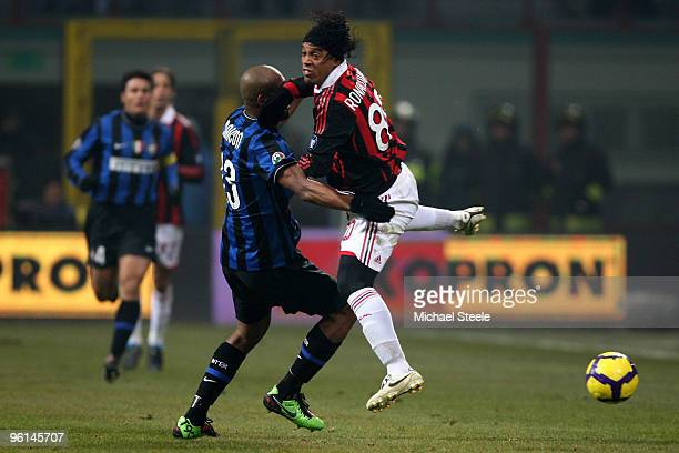 Ronaldhino of Milan challenged by Maicon of Inter during the Serie A match between Inter Milan and AC Milan at Stadio Giuseppe Meazza on January 24...