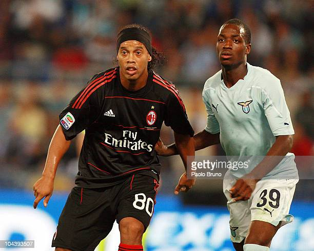 Ronaldihno of AC Milan and Luis Cavanda of SS Lazio look on during the Serie A match between SS Lazio and AC Milan at Stadio Olimpico on September 22...