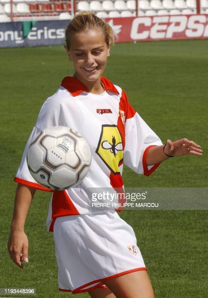 Ronaldinha Milene Domingues the wife of Brazilian soccer star Ronaldo plays with the ball 26 September 2002 during her presentation as Rayo...