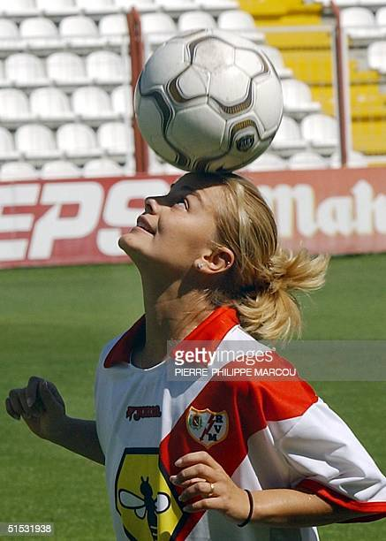 Ronaldinha, Milene Domingues, the wife of Brazilian soccer star Ronaldo, plays with the ball 26 September 2002 during her presentation as Rayo...